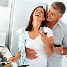 Couple laughing with wine