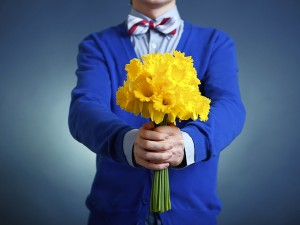 Man giving yellow flowers