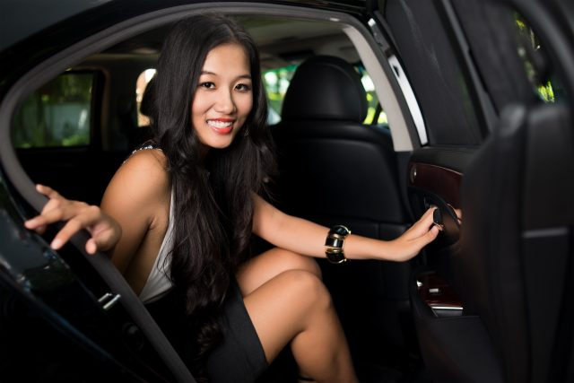 Glamorous beauty sitting in a lux car